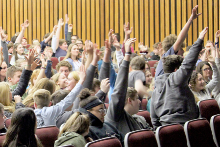 SEMS students raise hands during presentation (1/2020)