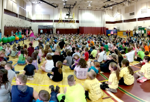 Students in gymnasium for ACES