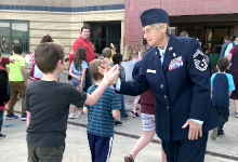 Student and Sergeant slap hands