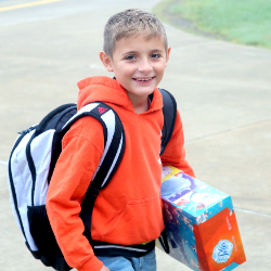 Boy student with tissue boxes (7/31/2020)
