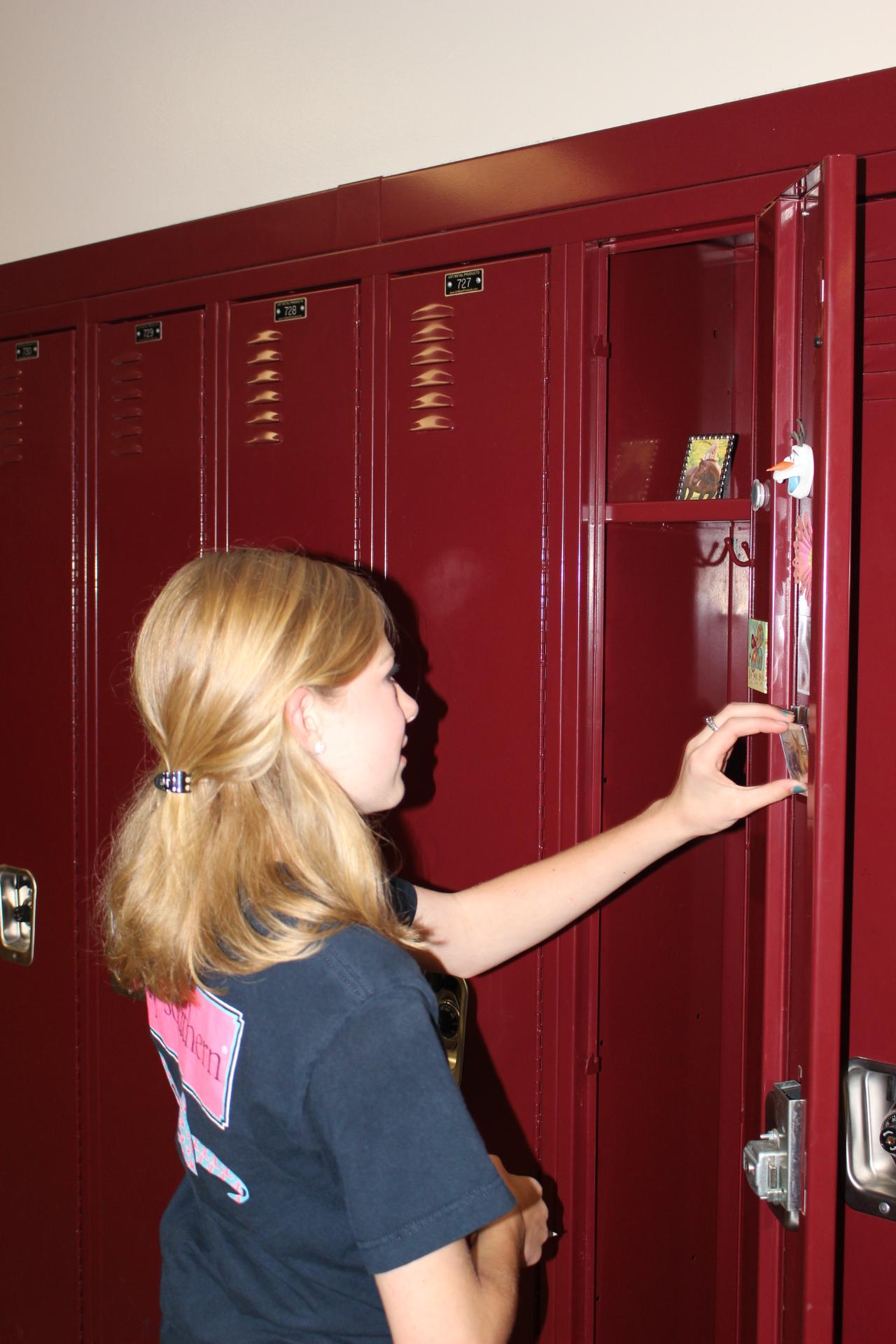 Student opens locker