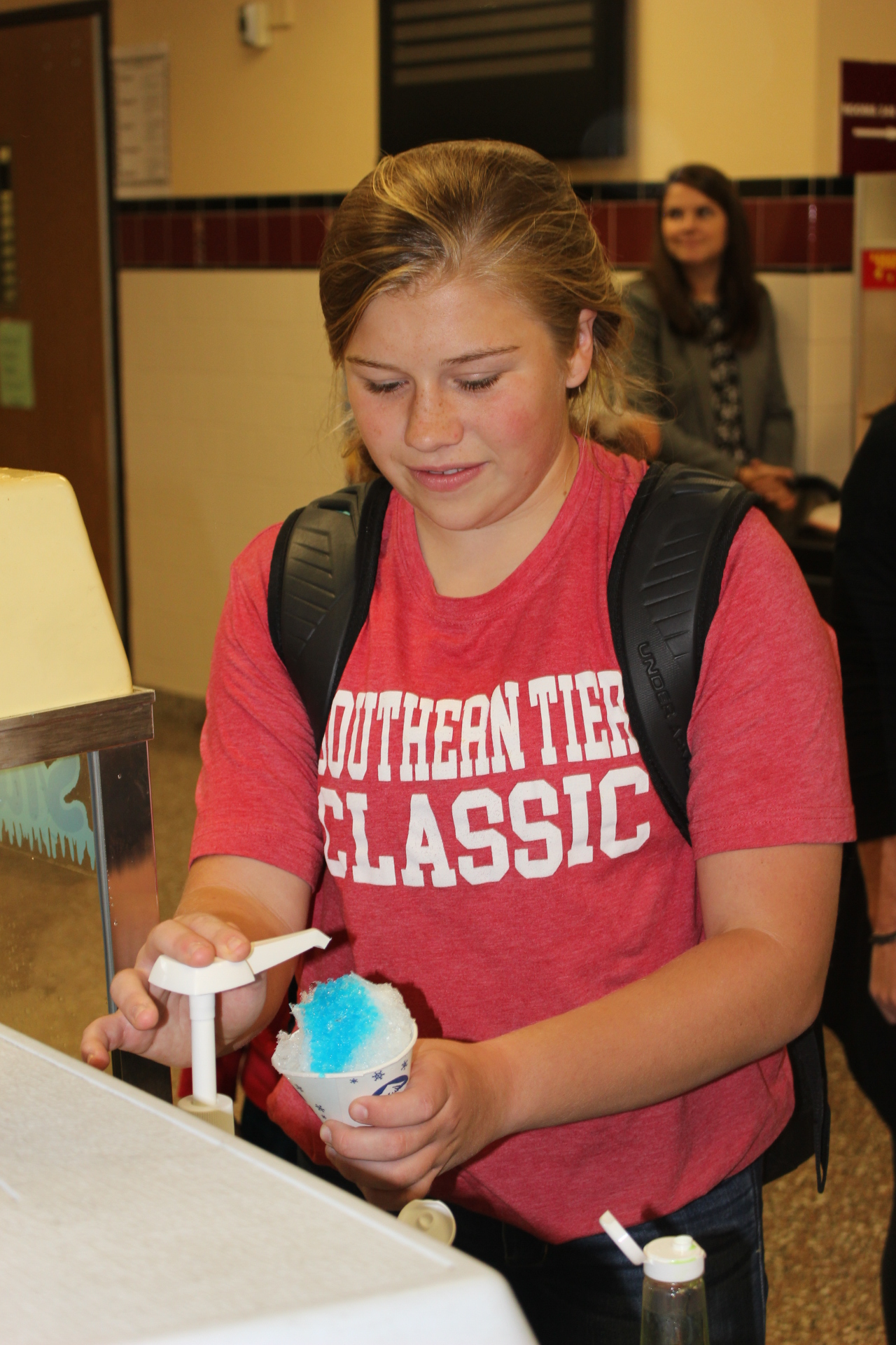 Student puts flavor on a snowcone