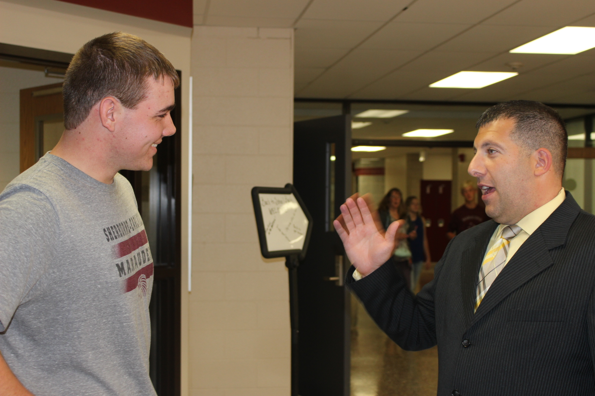 Mr. Colosi talks with a student at the Back To School Bash