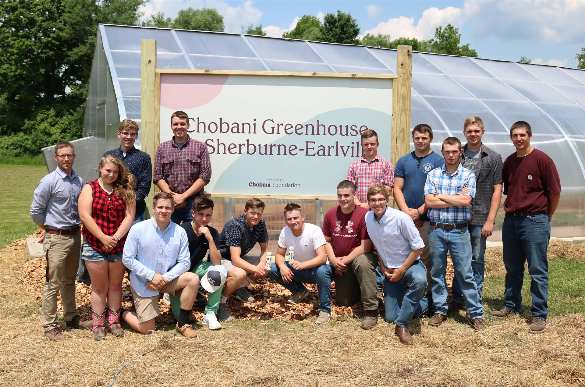Students and teachers at greenhouse