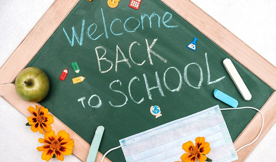 Welcome Back To School on chalkboard with decorative figures and mask (9/2020)