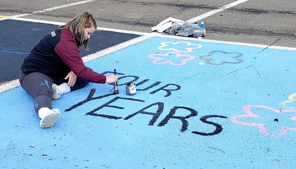 Student painting parking spot (12/2020)