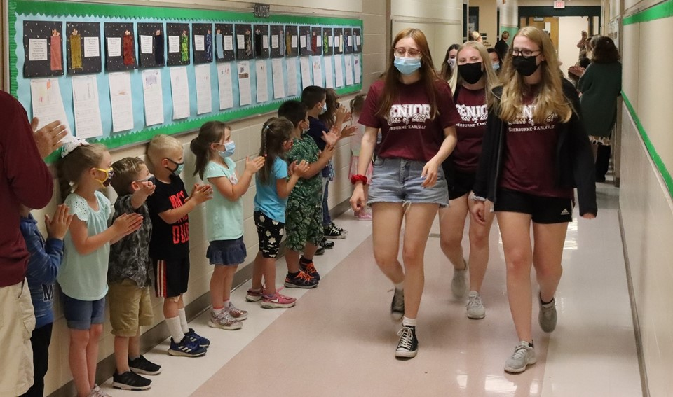 Students walk through elementary school